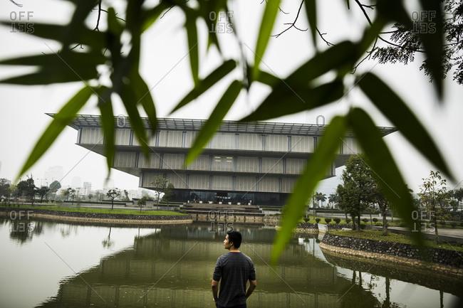 Hanoi, Vietnam - March 20, 2014: An exterior view through bamboo leaves of the Hanoi Museum in Hanoi, Vietnam.