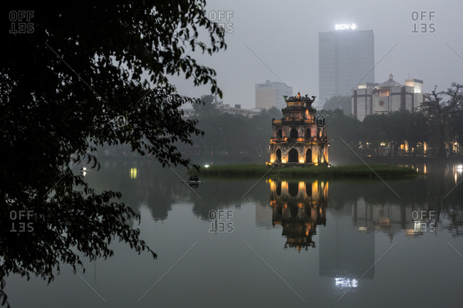 A dusk view of Turtle Tower, a legendary temple in the middle of Hoan Kiem Lake in downtown Hanoi, Vietnam.