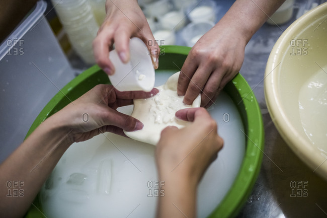 Cheese-making in the mountains of Dalat, in central Vietnam, Cream and curds are poured into burrata purses.
