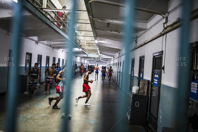 Bangkok, Thailand - November 6, 2014: Inmates exercise outside of their cells at Klong Prem prison in Bangkok, Thailand. The inmates are part of a program that pits prisoners against foreign Muay Thai fighters for a chance of reduced sentencing or early release.