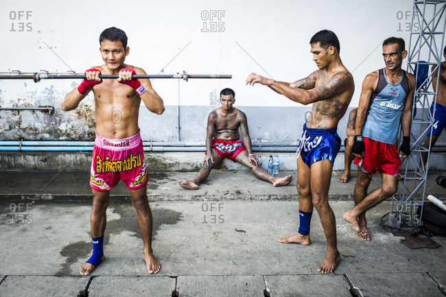 Bangkok, Thailand - November 6, 2014: Muay Thai training at Klong Prem prison in Bangkok, Thailand. The inmates are part of a program that pits prisoners against foreign Muay Thai fighters for a chance of reduced sentencing or early release.
