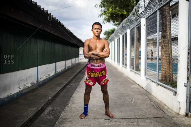 Bangkok, Thailand - November 6, 2014: An inmate at Klong Prem prison in Bangkok, Thailand. The inmate is part of a program that pits prisoners against foreign Muay Thai fighters for a chance of reduced sentencing or early release.