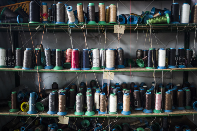 Shelves of colorful thread for sewing shoe soles at the Lien Phat factory in Binh Duong province in southern Vietnam.