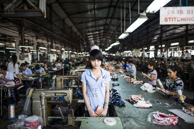 Binh Duong, Vietnam - December 9, 2013: A portrait of a young worker at the Lien Phat factory in the southern province of Binh Duong in Vietnam.