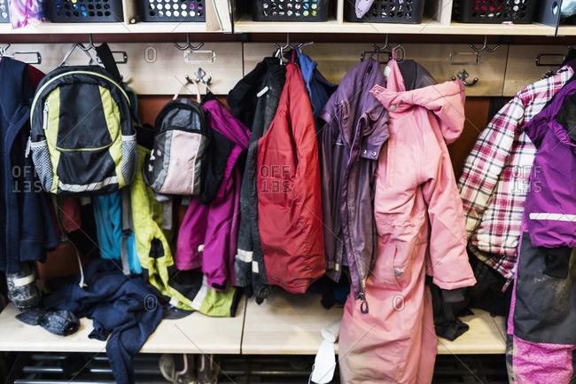 Winter coats and backpacks in wardrobe at kindergarten