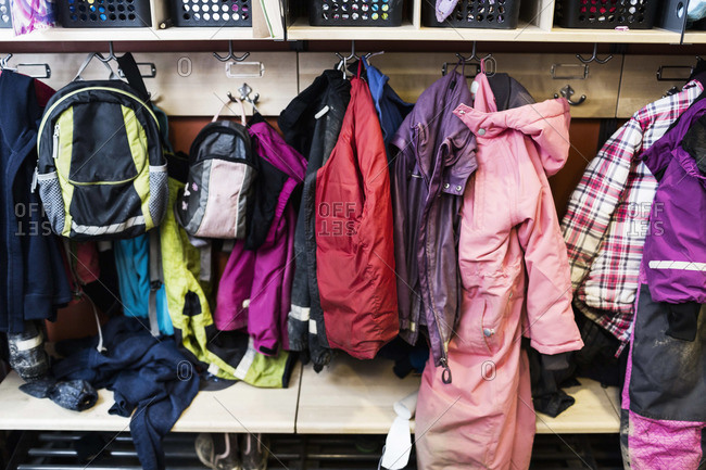 Winter coats and backpacks in wardrobe at kindergarten