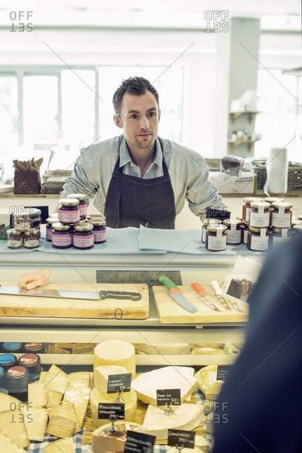 salesman at supermarket counter