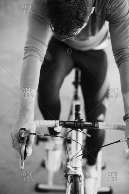 Mid adult man indoor cycling