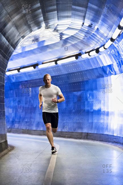 Man running through tunnel
