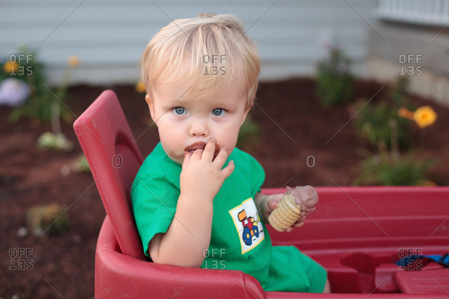 Young boy having a chocolate ice-cream