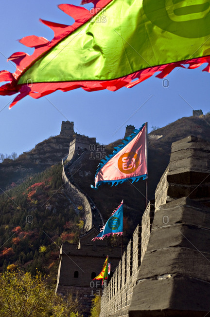 Colorful flags along the Great Wall
