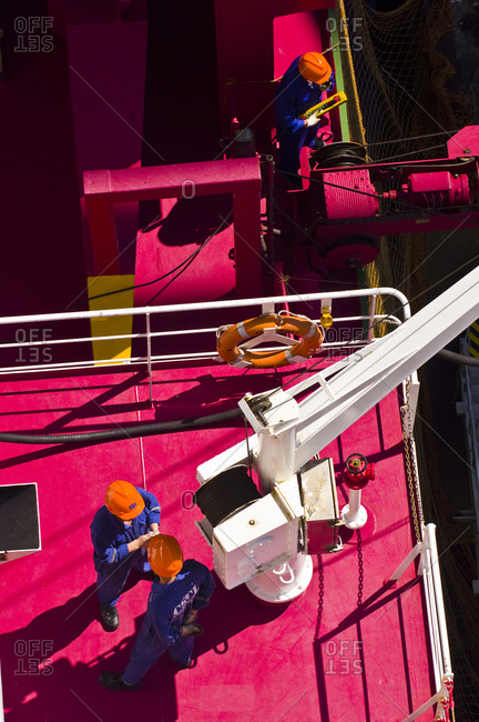 Overhead view of workers preparing to unload a ship