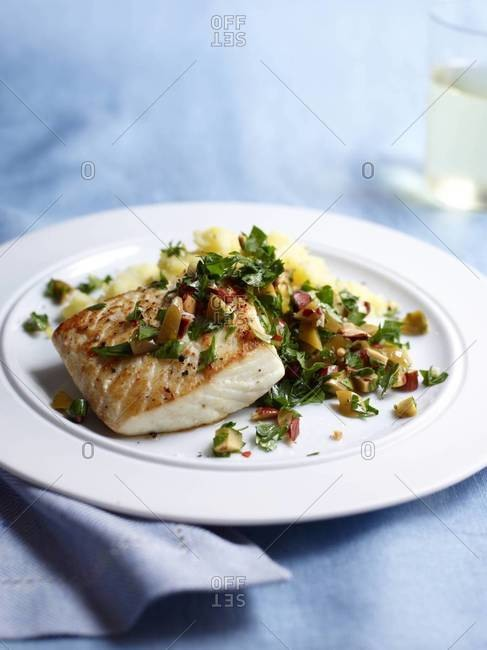 Seared white fish with olive relish and lemon mashed potatoes