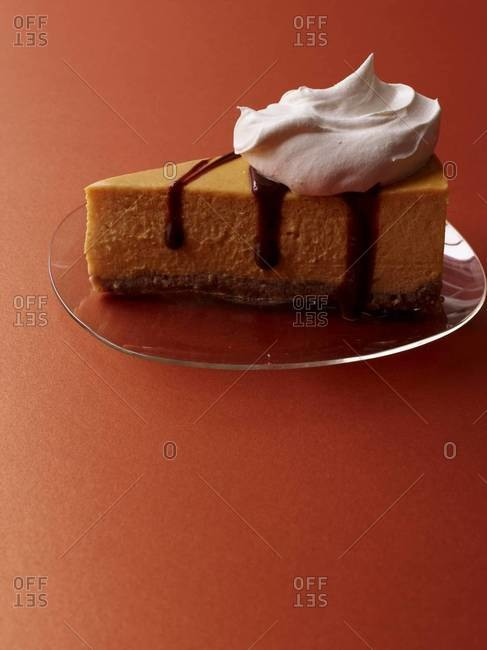 Pumpkin cheesecake with bourbon-spiked cream and chocolate sauce