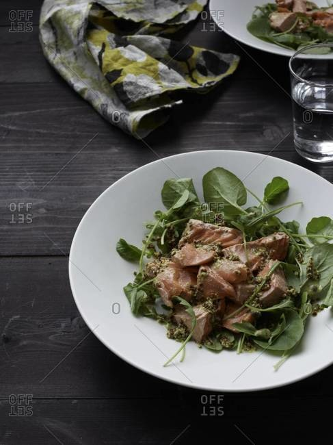 Poached salmon with baby arugula