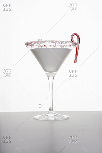 Cocktail with vermouth and candy cane