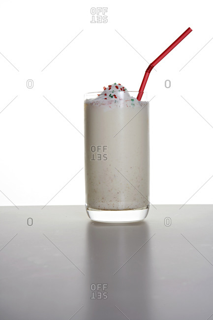Glass of eggnog with a straw