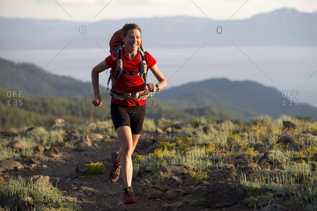 A woman, endurance athlete, fastpacking on the Tahoe Rim Trail.