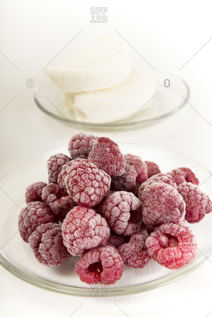 Glass plates of frozen raspberries and cream cheese