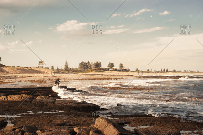 Australia, New South Wales, Tea Gardens, man at beach in the tide