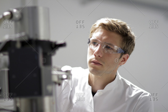 Portrait of scientist working at spectrometer in analytical laboratory