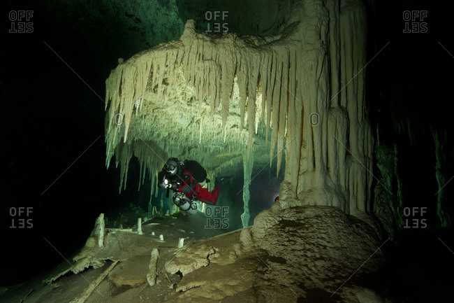 Cave diver exploring the system Nohoch Na Chich, Tulum, Mexico