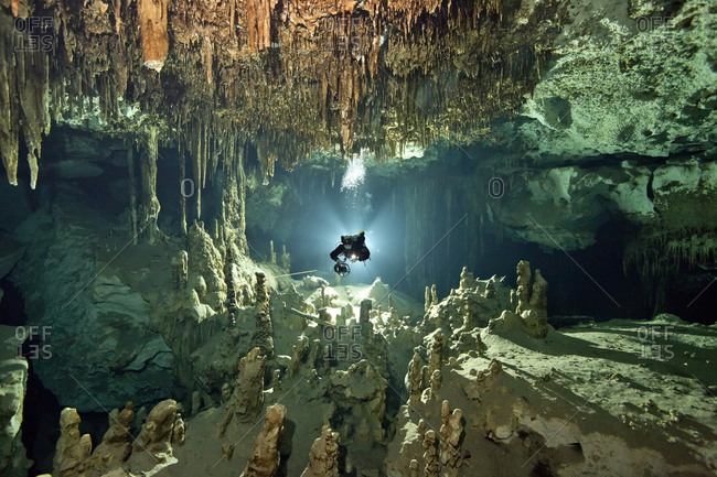 Cave diver in the system Dos Ojos, Tulum, Mexico