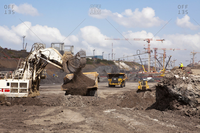 An excavator scooping earth at the Panama Canal Expansion on the Pacific side, near the Miraflores Locks