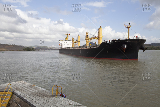 Cargo ship approaches the Miraflores Locks on the Panama Canal