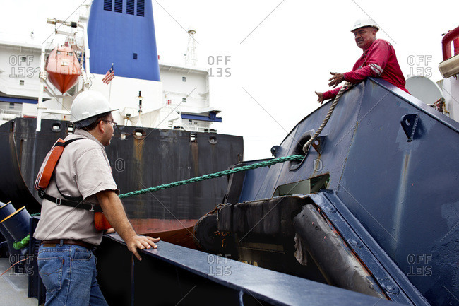 Crew members on a tugboat discuss strategy for transiting the Miraflores Locks on the Panama Canal