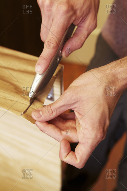 Hand cutting with utility knife