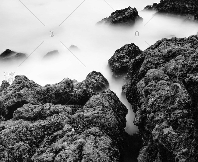 Rocks covered with sea smoke