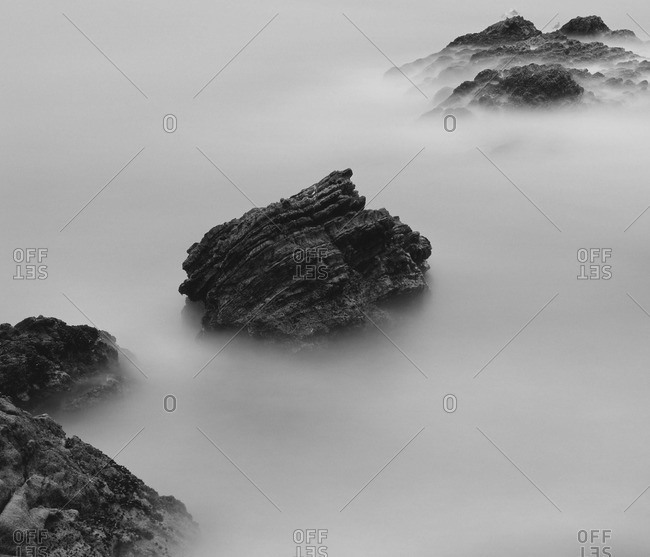 Rocks covered with sea smoke