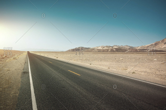Straight empty road in a desert