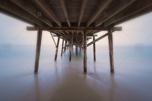 View under a pier in foggy weather