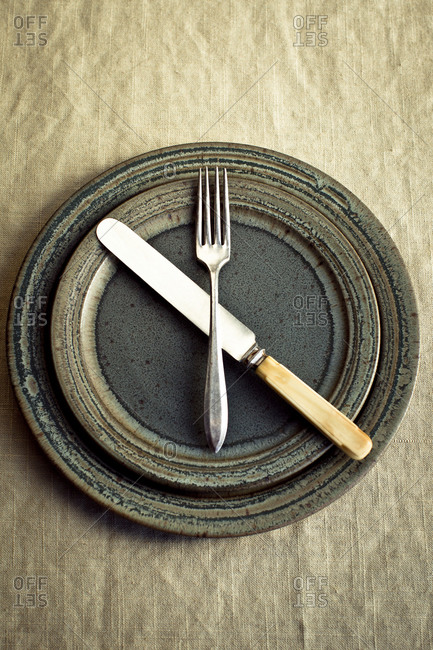 Empty plate with utensils on a table