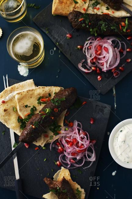 Lamb skewer with pitas and tzatsiki