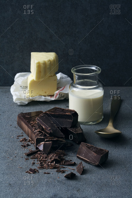 Butter, cream and dark chocolate on a table