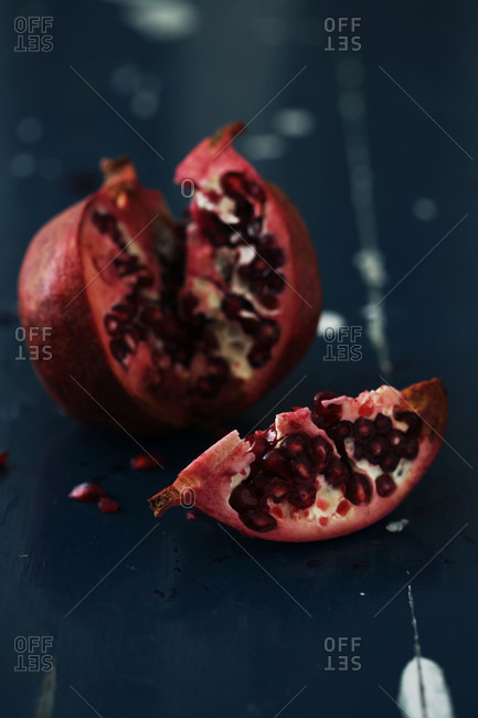 Close up of a pomegranate broken into pieces