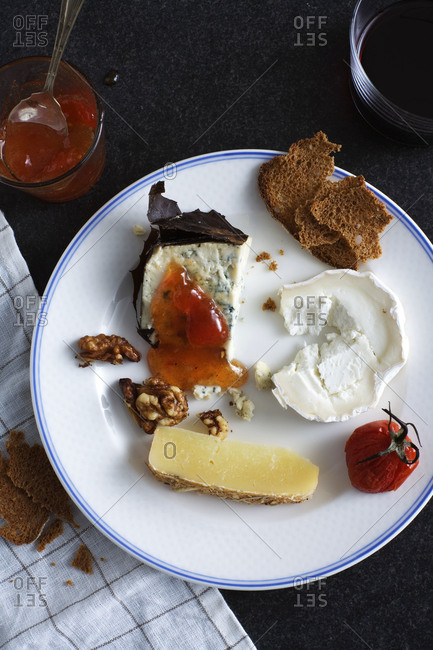 Various kinds of cheese with walnuts and marmalade
