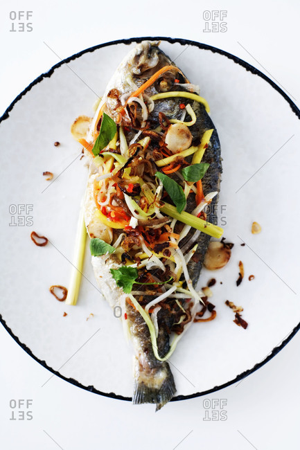Grilled fish with cilantro, carrot and red chili