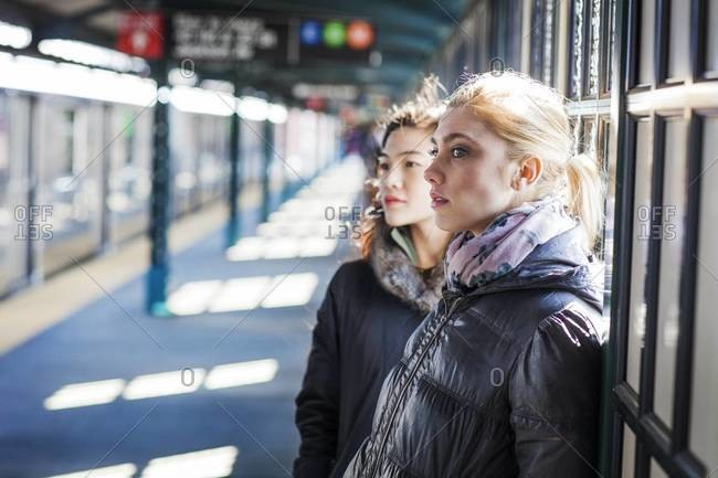 Young women waiting for a train at a station