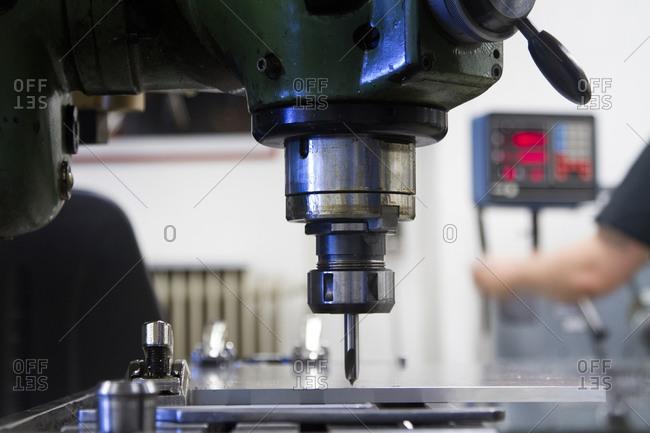 Female technician working in a metalworking workshop