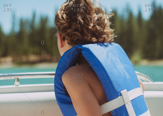 Back view of a boy wearing a life jacket