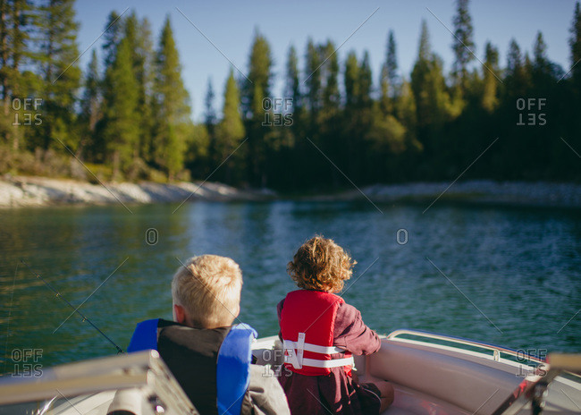Children sitting in a motorboat