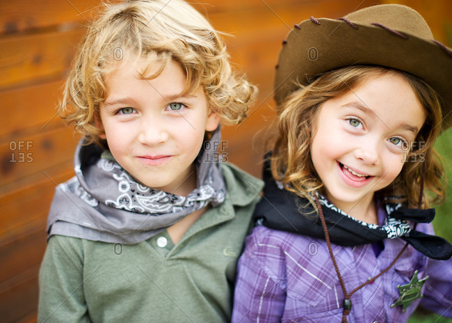 Portrait of fraternal twins in western costume
