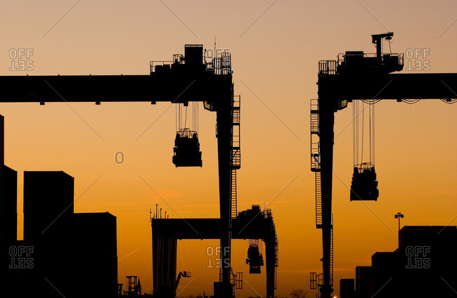 Silhouette of container cranes at sunset in Elizabeth, New Jersey, USA