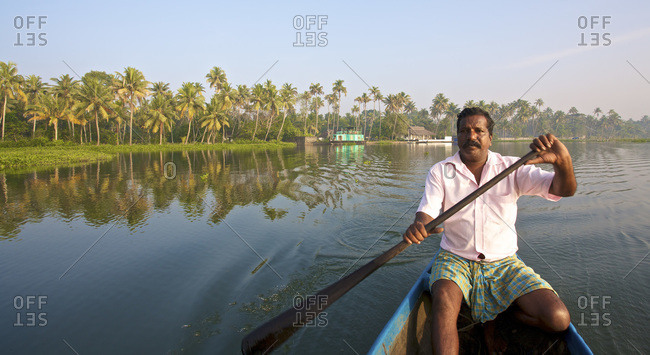 Kerala, India -  January 29, 2011: Boatman on the backwaters of Kerala, India
