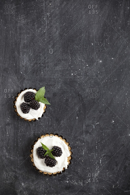 Tarts topped with blackberries