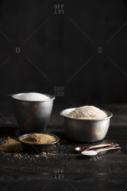 Metal bowls filled with baking ingredients